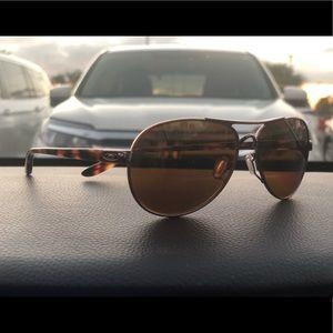 Oakley polarized woman's rose gold sunglasses